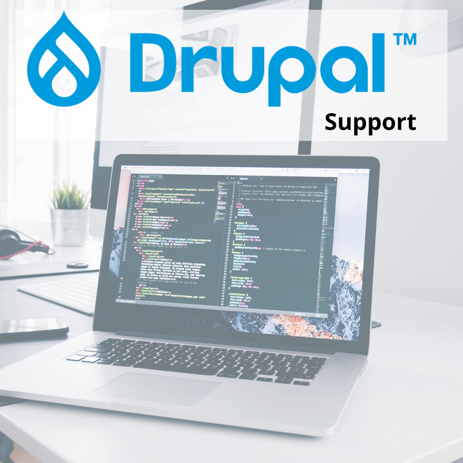 Laptop with Drupal code displayed.